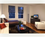 Financial District – No fee renovated studio apartment with high ceilings for $2,740